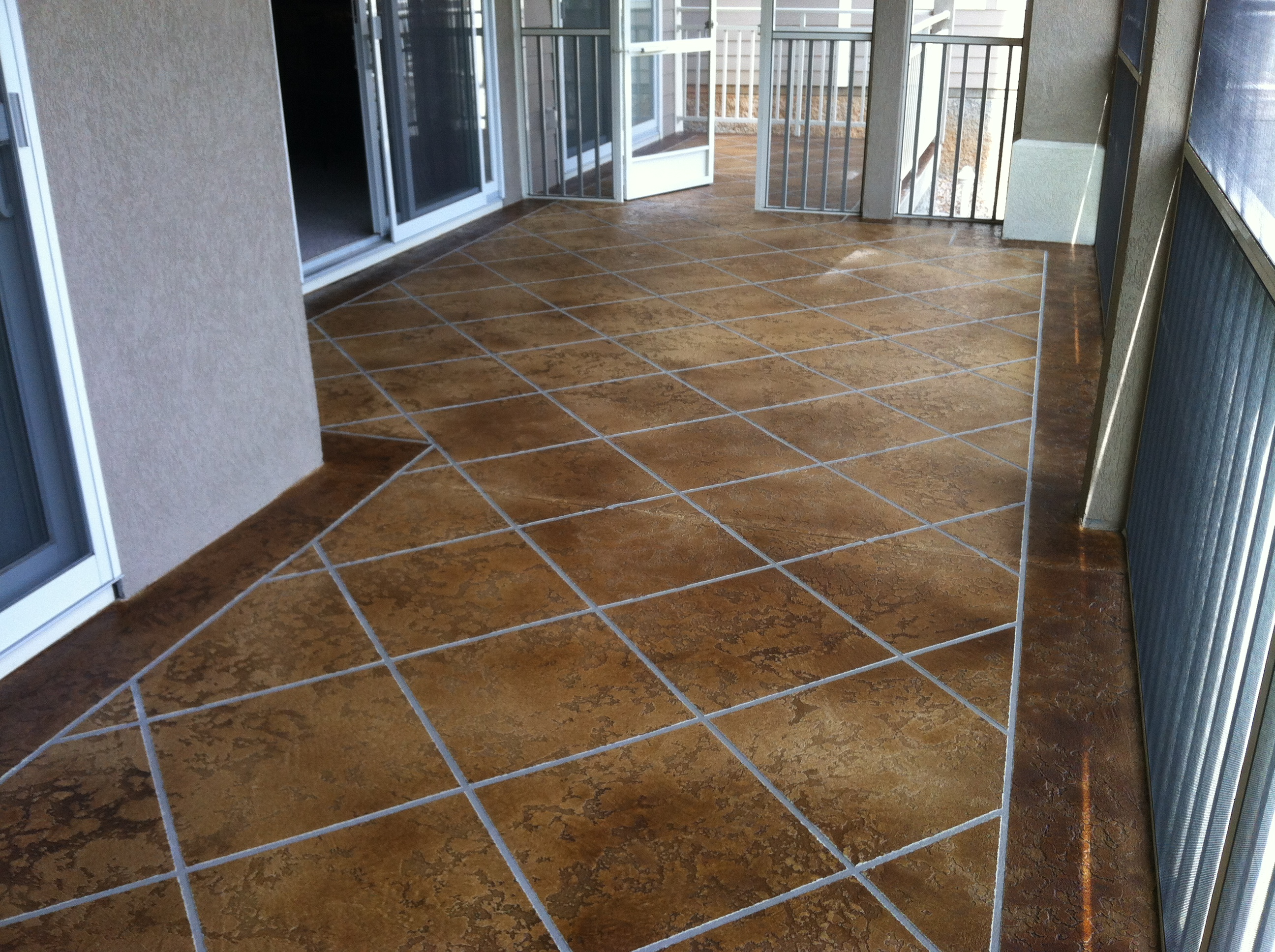 Concrete Condo Deck Osage Beach MO Acid Stained Faux Tile Flooring