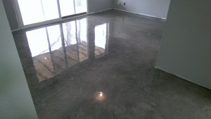 concrete basement floor antiqued charcoal coloring with epoxy finish