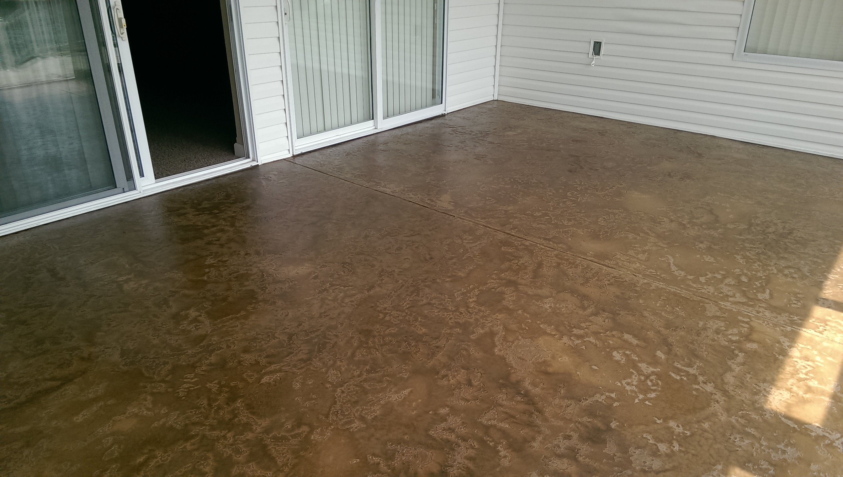 Custom concrete design lake ozark decorative concrete flooring decorative concrete condo deck tuscan slate texture brown antique stain lake of the ozarks mo dailygadgetfo Images